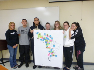 Students with map of Latin America